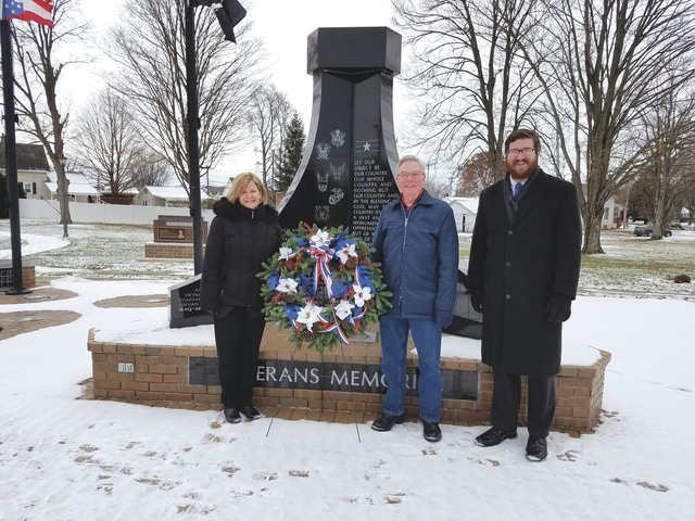 Provided photo Piqua Mayor Kazy Hinds places a wreath at Piqua's Veterans Memorial in solidarity with the ceremony at Arlington National Cemetery and the national movement to place Christmas or winter wreaths on the graves of veterans across America on Dec. 17. Assisting is James Robinson, an Air Force veteran who recently spearheaded the effort to refurbish the Veterans Memorial. Ben Zimmerman, far right, of the Jamieson & Yannucci Funeral Home, provided the beautiful wreath as a tribute to all veterans for their service to our country.