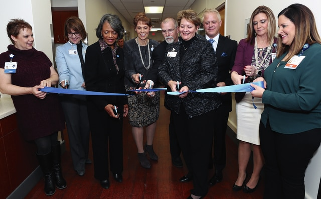 Provided photo Cutting the ribbon to the new UVMC Emergency Department on Dec. 14 were (left to right), Ivy Thoman of UVMC; Mary Boosalis, president, Premier Health; Anita Moore, chair of Premier Health Board of Trustees; Becky Rice, UVMC president; Dr. Rowan Nichol, chair, UVMC board of directors; Diane Pleiman, UVMC vice president, operations; Dr. David Cohen, UVMC ED medical director; Lisa Weaver, UVMC director of emergency services; and Heidi Harmer of UVMC.