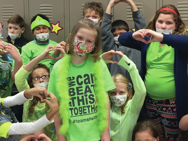 "Courtesy of Piqua Central Intermediate School Shelby Lockhart and students at the recent ""lime green-out"" at Piqua Central Intermediate School to show support for Lockhart as she continues to battle leukemia."