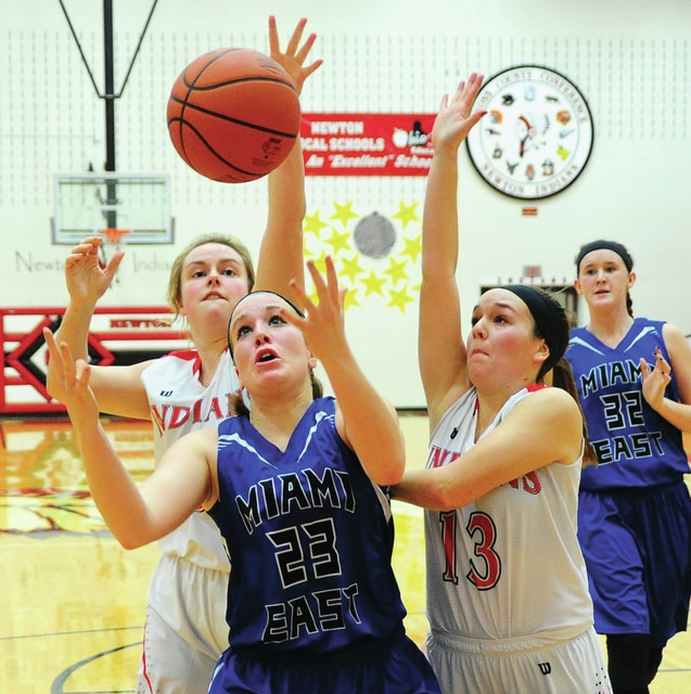 Mike Ullery | Daily Call Amber Kinnison (23) of Miami East, and Kaylee Kesler (13) of Newton, reach for a rebound.