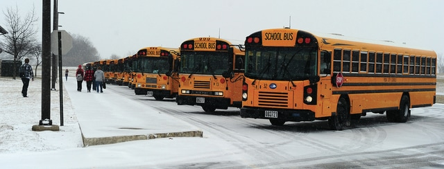 Mike Ullery | Daily Call Students from Piqua High School board buses for the trip home from school on Thursday. Despite bitter cold temperatures, the only school interruption this week was a two-hour delay on Friday. Forecasts call for temperatures to remain below freezing until Monday.