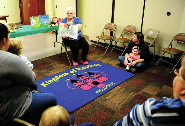 Piqua Public Library employee Sharon Kiser reads a book to children during the weekly Story Time on Thursday morning. Story Time is held weekly at 10:30 a.m. on Thursdays.
