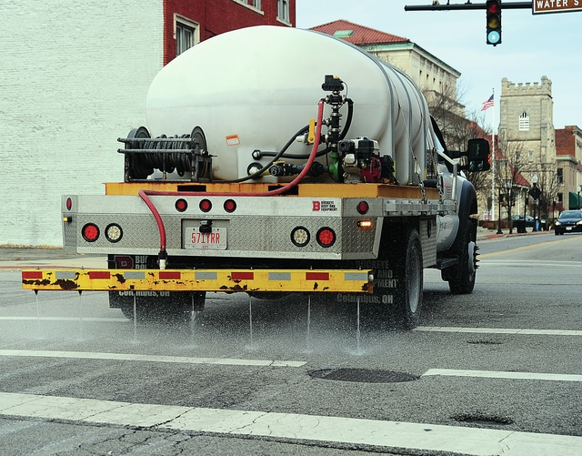 Mike Ullery | Daily Call A City of Piqua employee applies salt brine to pre-treat city streets in the downtown area on Friday in anticipation of ice and freezing rain that is being forecast for Saturday and Sunday.
