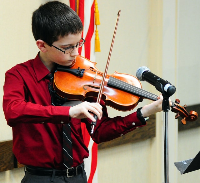 """Matthew Galbreath, a sixth-grade student from Piqua Catholic, performs """"Let There Be Peace on Earth"""" on the violin during Monday's annual Martin Luther King, Jr. Celebration at the Piqua YWCA."""