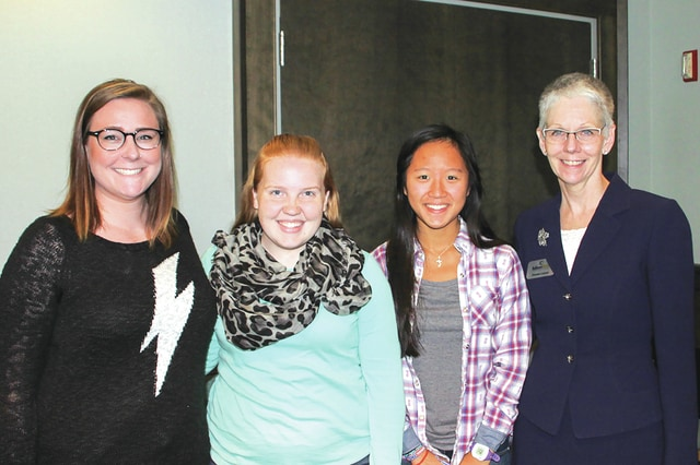 Provided photo Laura Parker,of Troy, Samantha Greene of Piqua, and Juliya Hsiang of Piqua, are congratulated by Edison State Community College President Dr. Doreen Larsen for being three of four Edison State students chosen to participate in Sen. Sherrod Brown's Propel Ohio summit. Rebecca Buck of Fairborn, is not pictured.