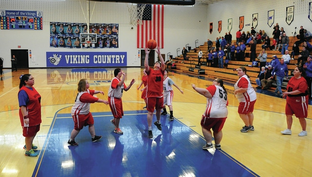 Mike Ullery | Daily Call Paula Baker, 2, scores as the Riverside Special Olympics women's basketball team took the floor during half-time of the Miami East/Bradford girls basketball game on Saturday.