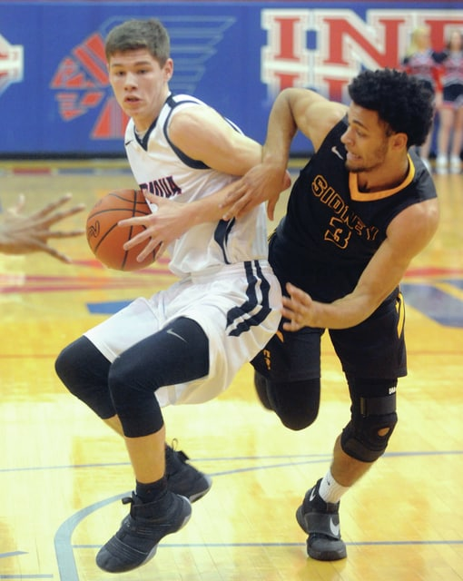 Mike Ullery | Daily Call Piqua's Hayden Shrubb drives to the hoop against Sidney's Jace Conrad.