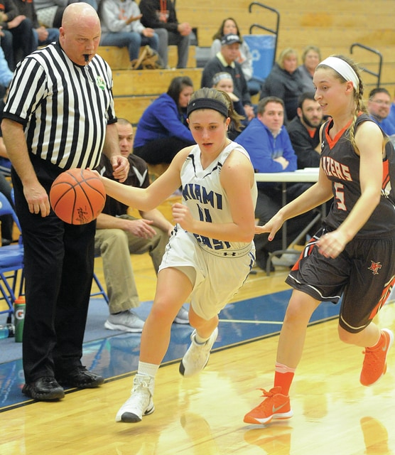 Mike Ullery   Civitas Media Miami East's Anna Jacomet (11) drives around a National Trail defender Thursday.