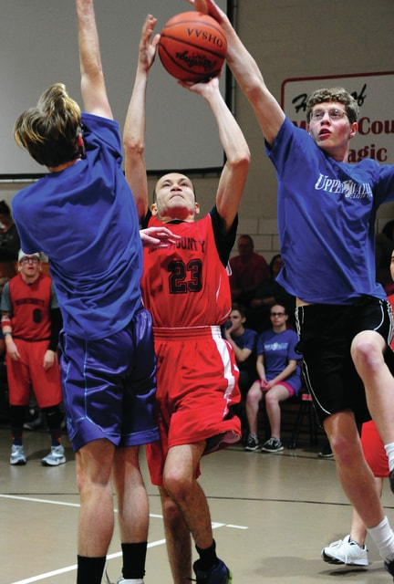 Mike Ullery | Daily Call Miami County Magic Special Olympian Antwan Hill, 23, looks to get off a shot as Upper Valley Career Center IM students Darian Kaltenbach and Dakota Gillette play defense during Friday's annual contest between Riverside's and the Upper Valley Career Center.