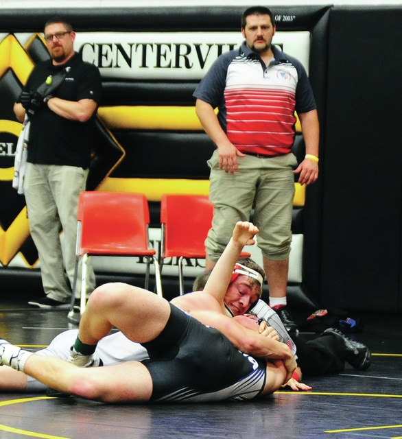 Mike Ullery | Daily Call Piqua's Brennan Hicks gets a first-round pin against Jacob Washburn of Xenia Friday in Centerville D-I 2 sectional action.