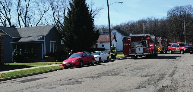 Mike Ullery   Daily Call Firefighters from Piqua and Covington work at the scene of a reported structure fire in the 1000 block of Boone Street in Piqua on Sunday afternoon.
