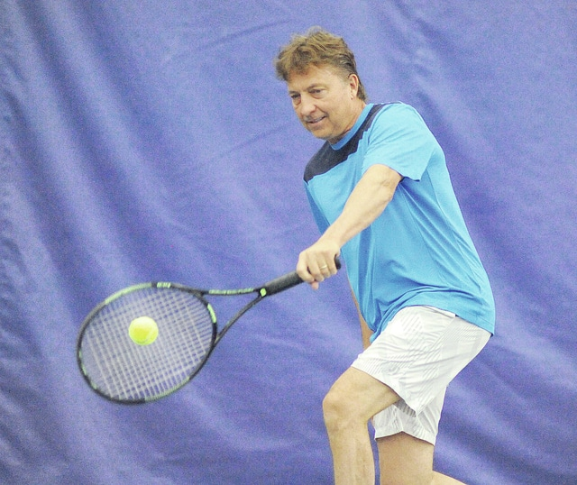 Anthony Weber | Troy Daily News Tennis professional Bud Schroeder hits a few balls Thursday at his complex, the Schroeder Tennis Center, in Tipp City.