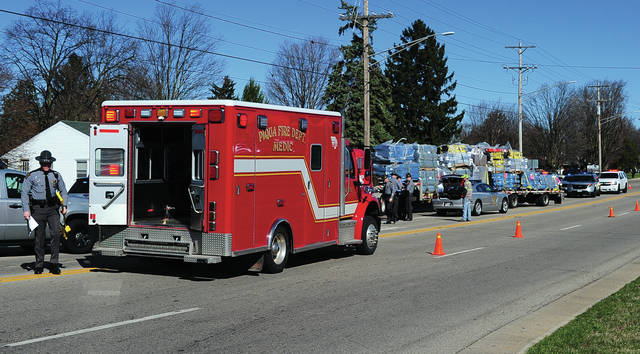 Mike Ullery | Daily Call EMS personnel from the Piqua Fire Department, along with the Ohio State Highway Patrol, and Piqua Police Department work the scene of an incident on Looney Road near East Ash Street on Wednesday morning where troopers discovered a semi sitting in the middle of the roadway with the driver slumped over the steering wheel, unresponsive.