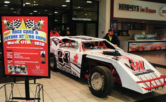 Mike Ullery | Daily Call One of some 95 race cars is pushed in to the Miami Valley Centre Mall on Thursday night as the 2017 Race Cars & Future Stars Expo is set to kick off. The event will feature race cars of all sorts, pulling tractors, and a line-up of entertainment throughout the weekend.