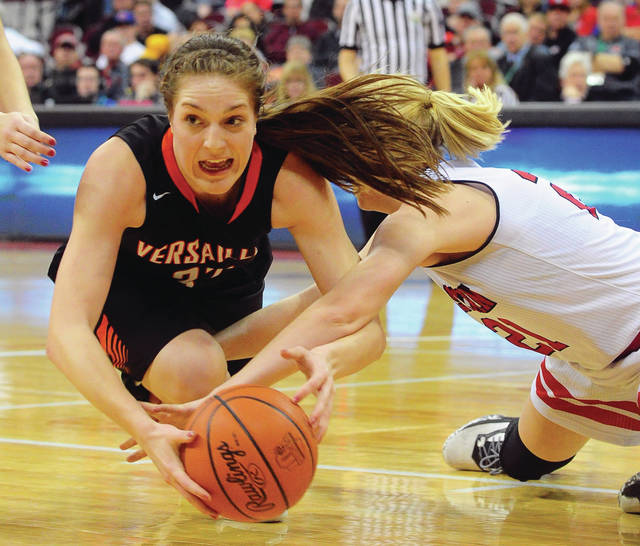 Mike Ullery | Daily Call Versailles' Danielle Winner (32) scrambles for a loose ball with Allison Day of Winchester Eastern in Friday's Division III OHSAA state semi-final game against at the Schottenstein Center.