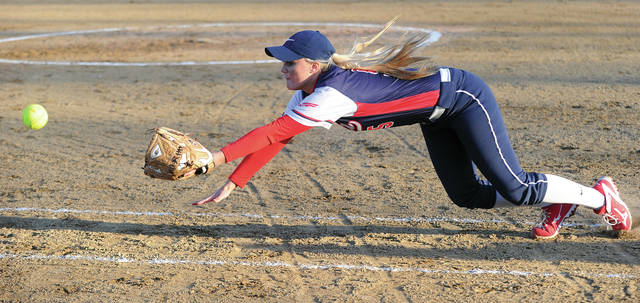 Mike Ullery/Call File Photo Rayna Brownlee makes a diving stop last season.