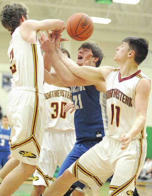 Anthony Weber/Civitas Media The Northeastern defense had Miami East's Logan West surrounded all night Wednesday at Northmont High School.