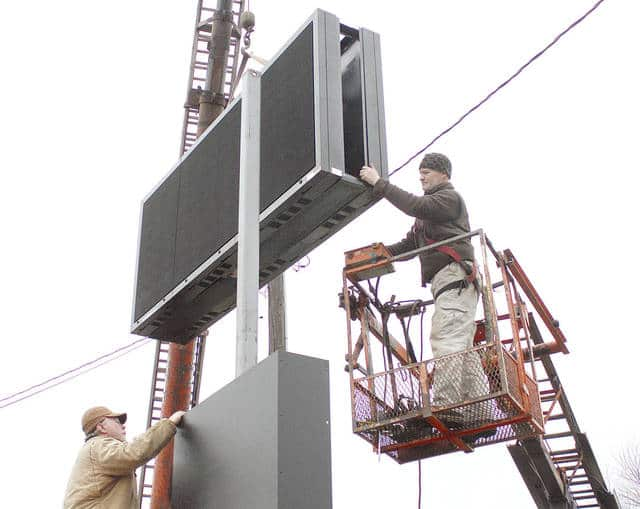 Anthony Weber | Troy Daily News Workers from Wilson Electronic Displays of Dayton construct a new digital sign Tuesday at the Miami County Fairgrounds. The sign, which stands approximately 14 feet tall, will scroll through and promote upcoming events — and sponsorships — at the Miami County Fairgrounds, including the Miami County Fair, and will be more visible to the community. Funding for the sign was through an Ohio Department of Agriculture Capital Grant, which designated funding for improvement to fairgrounds throughout the state of Ohio, and received by the Miami County Agricultural Society, according to director Roberta Jacobs. A bathroom project near the horse arena/Pence Building will also begin soon as a result of the grant, she said.