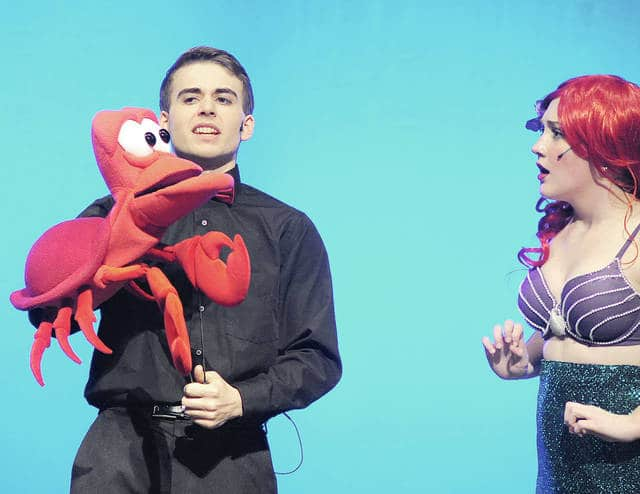 "Anthony Weber | Troy Daily News Jackson Tucker portrays Sebastian and Miranda Rike plays Ariel in Miami East High School's production of ""The Little Mermaid."""