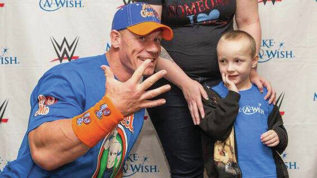 "Provided photo Professional wrestler John Cena (left) does signature ""You can't see me!"" hand motion when meeting Brantley Burton, 4, of Piqua (right), this month."