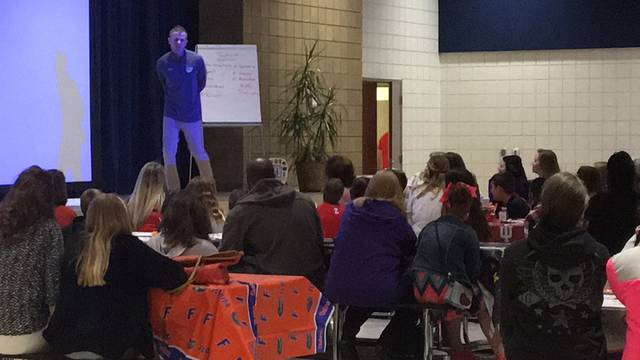 Sam Wildow | Daily Call Piqua High School boys basketball coach and teacher Heath Butler speaks at third quarter Breakfast of Champions event at Piqua Central Intermediate School on Friday morning.