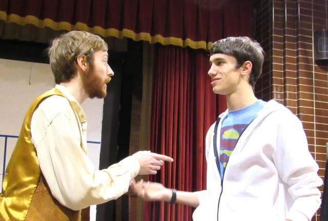 """Provided photo Will Hoersten as John the Baptist and Conor O'Leary as Jesus perform in a modern-day production of """"Godspell"""" at Lehman Catholic High School."""
