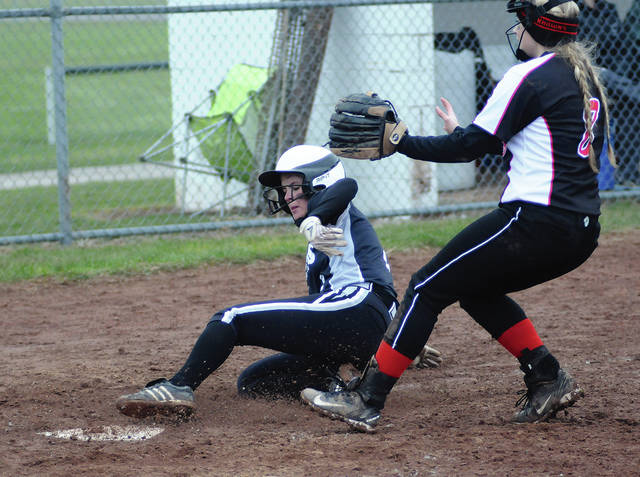 Ben Robinson/GoBuccs.com Covington's Ashley Cecil slides across the plate with a run against Mississinawa Valley.