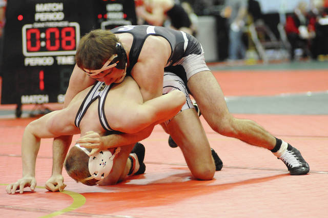 Ben Robinson/GoBuccs.com Covington's Lance Miller controls Josh Doherty of West Jefferson Friday in the quarterfinals.