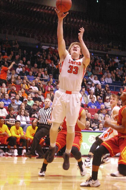 Kyle Shaner/Civitas Media Versailles A.J. Ahrens goes up for two points Thursday night.