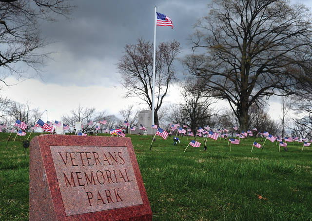 Mike Ullery | Daily Call Spring has sprung and U.S. Flags flutter in a brisk April breeze through the Veterans Memorial Park section at Forest Hill Cemetery on Tuesday.