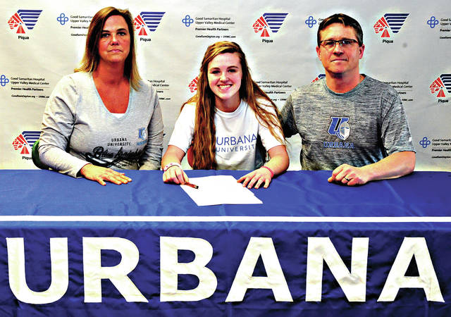 Mike Ullery | Daily Call Madison Curtner signs her national letter of intent to play soccer at Urbana University as her parents Patty and Adrian look on.