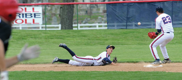 Mike Ullery | Daily Call Shortstop Owen Toopes makes a diving stop before tossing the ball to Spencer Lavey, 23, for a force at second base.