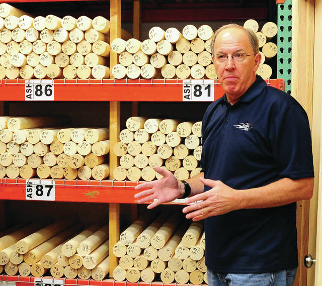 Mike Ullery | Daily Call Piqua native and majority owner John Hinsch talks about the process of selecting the right, approximately, five-pound piece of blank wood that will transformed into a slightly over two-pound professional baseball bat, during a tour of the Columbus-based Phoenix Bats factory earlier this week.