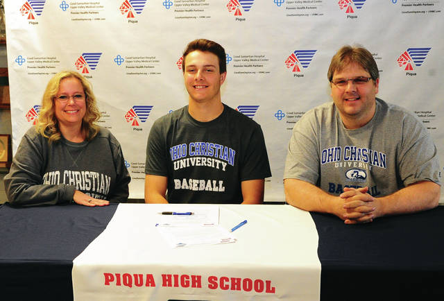 Mike Ullery | Daily Call Blake Wright signed his letter of intent to play for Ohio Christian University Thursday morning. Shown with right are his parents Tammy (left) and David (right) Wright.