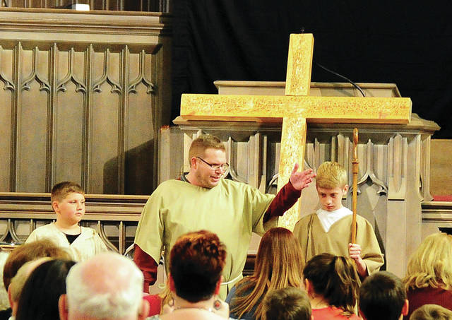 Mike Ullery | Daily Call Soloist Adam Jacomet, along with Seth Jacomet and Andrew Holmes, perform Watch the Lamb during Friday's annual Piqua Community Good Friday Service, at Greene Street United Methodist Church. The annual event is sponsored by the Piqua Association of Churches.