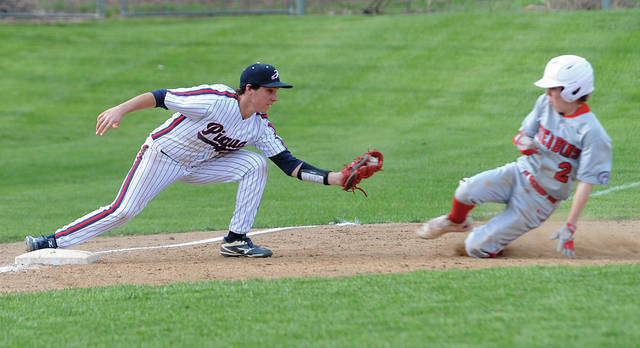 Mike Ullery | Daily Call Piqua's Spencer Lavy puts the tag on a Stebbins' Owen Holland trying to steal third.