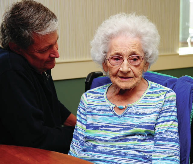 Mike Ullery | Daily Call Piqua Manor resident Deloris Herbe, who will celebrate her 100th birthday on Tuesday, shares life stories as her son Jerry, proudly looks on.