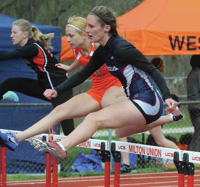 Mike Ullery | Daily Call Piqua's Faith King runs the 100 meter hurdles event.