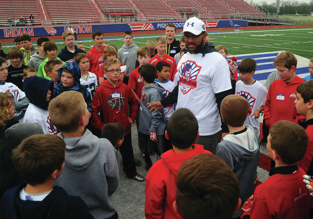 Mike Ullery/Call Photo Piqua native and former Ohio State Buckeye and Green Bay Packer, Brandon Saine, speaks to kids attending the second annual Brandon Saine Football Skills Camp at Alexander Stadium/Purk Field last April.