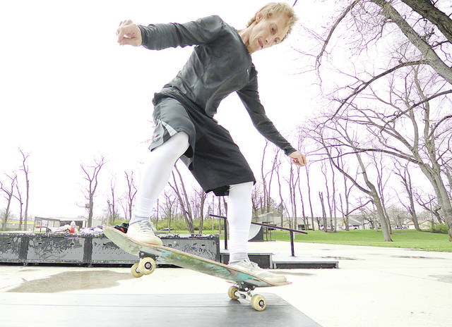 Anthony Weber | Troy Daily News David Smith of Troy took advantage of the warmer weather Tuesday in Troy. Smith and several buddies visited the skate park on Ridge Avenue to practice some grinds and slides during the day. Temperatures in the area are expected to drop into the 40s with possible rain and snow ahead.