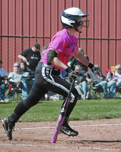 Anthony Weber/Troy Daily News Covington's Morgan Studebaker (15) breaks out of the batter's box Saturday against Ben Logan at Newton High School.