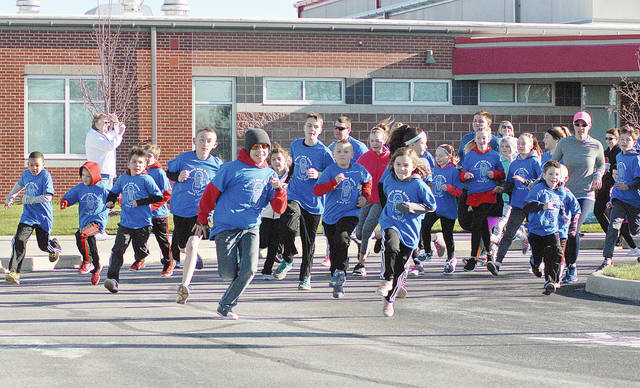 "Anthony Weber | Troy Daily News A Heart and Soles 1-mile fun run and 5K run kicked off Saturday morning in Pleasant Hill. The annual event honored six of its community members with support of the community, along with students and staff at Newton Local Schools. The fundraiser allows assistance for medical bills and scholarships. ""It takes the village,"" Brian Leingang said."