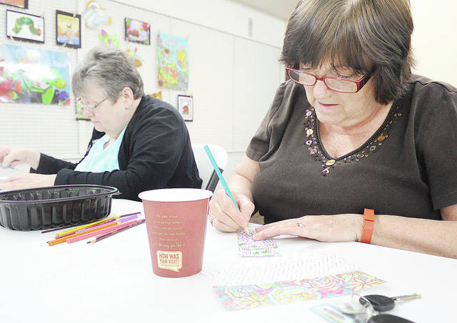 "Anthony Weber | Troy Daily News Participants of Color and Coffee, including Hannelore Zimmerman, left, and her sister, Inge Voisard, gathered for the event on Tuesday at the Troy-Miami County Public Library. Join the staff at the library for Coffee and Color again on Tuesday, April 25, sponsored by StoryPoint. The group meets every other Tuesday at the facility in Troy. Coloring pages, colored pencils and coffee will be provided. ""It beats sitting in front of the television,"" Zimmerman said."