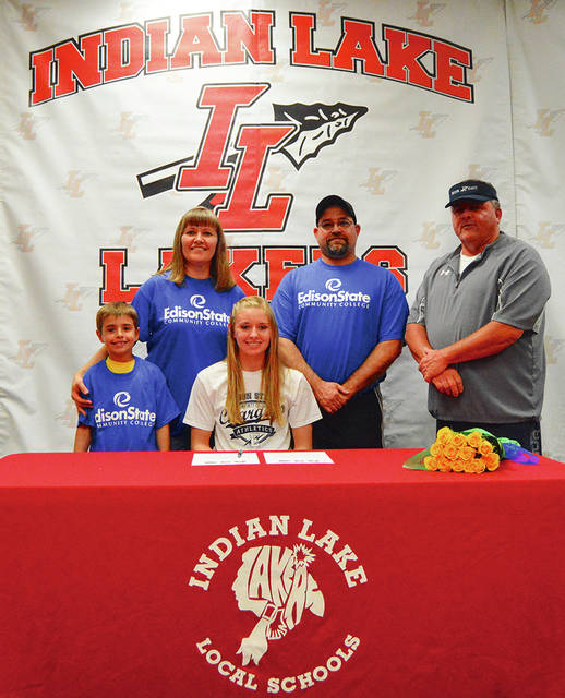 Photo Provided Hailey Wallace signed her letter of intent to play softball for Edison State Community College. Shown with her are parents Ron and Becky, brother Holden, and Edison State coach Dan Cain.