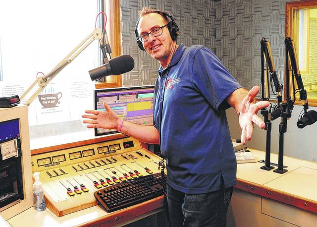 Joe Laber, of Troy, hams it up on Tuesday in his new studio at WPTW radio in Piqua. He played tunes and did remote broadcasts for 10 years at WMVR in Sidney before leaving the station on March 31.
