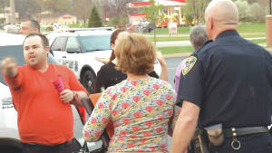 Courtesy of WDTN Protesters and police gather outside a town hall meeting held by Ohio Rep. Warren Davidson on Tuesday night.