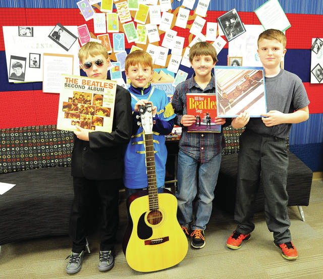 """The Beetles were one of many wax museum historic figures who appeared at Washington Primary School on Thursday. Carson Reichelder portrayed John Lennon, Jesse Baker as George Harrison, John Hess as Paul McCartney, and Trenton Ball as Ringo Starr. Washington third-grade students chose men and women who had made a contribution to our history, researched their chosen person, then dressed as their favorite a did a first-person """"living"""" biography for teachers and guests."""
