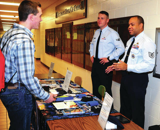 Mike Ullery | Daily Call A1C Ben Kriz and TSGT Troy Morris of the USAF recruiting station in Piqua chat with students about careers and education possibilities in joining the United States Air Force, during a visit to Piqua High School on Thursday .