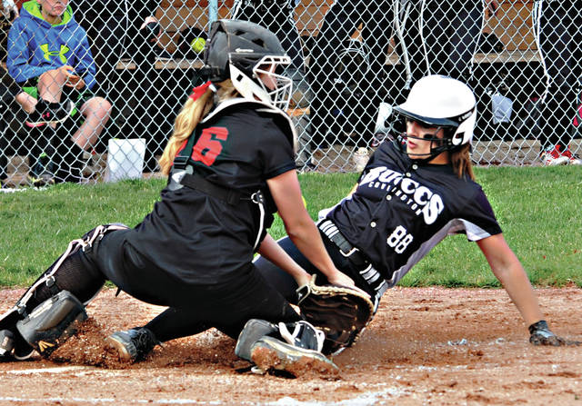 Mike Ullery | Daily Call Covington's Emma Dammeyer scores on a double steal against Fort Loramie Thursday.