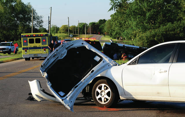 Mike Ullery | Daily Call EMS and fire units from Tipp City Fire, along with Miami County Sheriff's Deputies investigate a two-vehicle crash at the intersection of Peters Road and Kessler-Cowlesville Road on Monday evening.